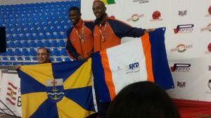 Foto: Coronel Otavio, ao lados dos irmãos campeões.